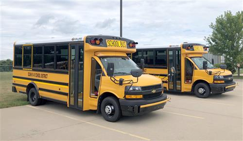 Ttwo of the three 30-passenger buses the District purchased through a state reimbursement program.
