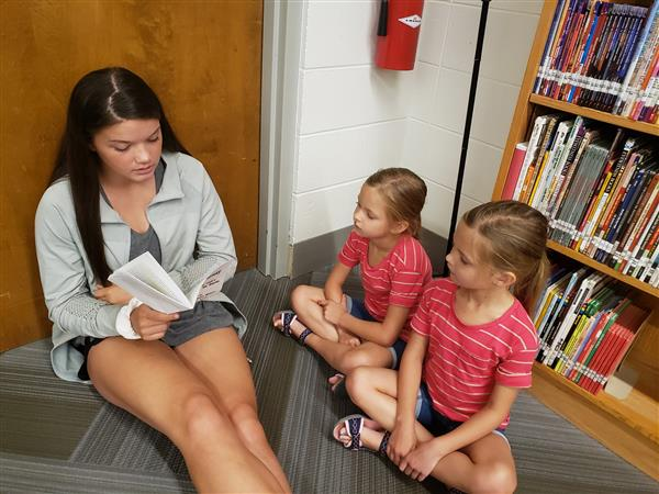 OJH students read to South Elementary first-graders.
